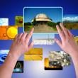 Hands choosing photos on virtual desktop — Stock Photo