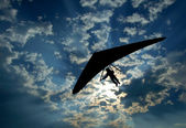 Hang glider silhouette on sky — Stock Photo