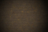 Perforated metal background — Stockfoto