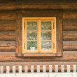 Window of a old wooden cottage — Stock Photo