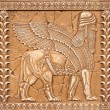 stone carving lamassu or shedu in mesopotamia mitology — Stock Photo