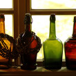 Glass bottles on windowsill — Stock Photo #18387525