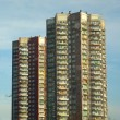 Older high-rise apartment building. live in high-rise - Stock Photo