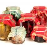 Jars of preserves on white — Stock Photo #25008165
