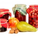 Jars of preserves on white — Stock Photo #25008185