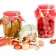 Jars of stocks for the winter on white - Photo