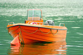 Orange rescue boat on the water — Stock Photo