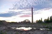 Abandoned factory with smokestacks — Stock Photo
