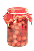 Jar of cherry on winter, isolated background — Stock Photo