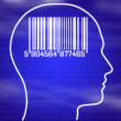 Bar code in head on blue background — Stock Photo