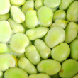 Broad beans in boiling water — Stockfoto