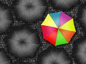 Many colors umbrella. Bright umbrella among set of black umbrell — Stock Photo