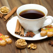 Porcelain coffee cup on the table. Garnish with star anise, cinnamon — Stock Photo