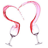 Red wine splash, heart shape over white background. — Photo