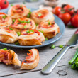 Puff pastry rolls with ham and chese. Baked snacks — Stock Photo #45545835
