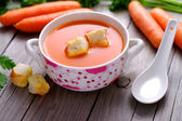 Carrot  soup in a porcelain bowl.  — Stock Photo