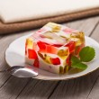 Fruit dairy, red and green jelly on a plate. — Stock Photo