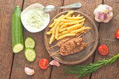 Cevapcici with tzatziki. The traditional Balkan dish — Stock Photo