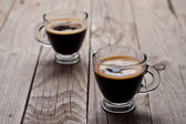 Closeup of two small cups with espresso. — Stock Photo