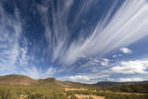 Sweeping clouds over South African landscape. — Stock Photo
