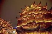 Traditional buildings lit up at night time in the Old Town, Nanshi, Shanghai, China — Stock Photo