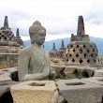 Buddha statue missing its perforated stupa cover, Borobudur, Indonesia. — Stock Photo #37649487