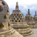Five stupas conceling Buddha statues, Borobudur, Indonesia. — Stock Photo