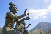 Buddhistic statues praising & making offers to the Tian Tan Big Buddha, on Lantau Island, Hong Kong, China. — Stock Photo