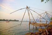 Traditional Chinese fishing nets at sunset, Cochin, India. — Stock Photo