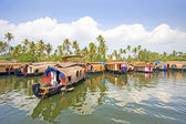 Traditional House boats moored together along the banks of the backwaters of Alleppey, Kerala, India. — Stock Photo