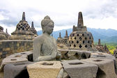 Buddha statue missing its perforated stupa cover, Borobudur, Indonesia. — Stock Photo