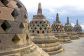 Five stupas conceling Buddha statues, Borobudur, Indonesia. — Stock Photo