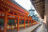 Bronze lanterns hanging in the grounds of Kasuga-Taisha Shrine, Nara, Japan. — Stock Photo