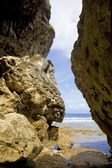 Exiting Avaiki caves on to the beach, Niue Island, South Pacific. — Stock Photo