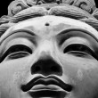 Close up of female buddhist statue face. — Stock Photo