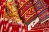 Pile of north african rugs in red, orange & brown shades, Morocc — Stockfoto