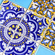Close up of traditional Spanish ornate ceramic wall tiles. Multi coloured with pale & dark blues & yellow. — Stock Photo #37931821