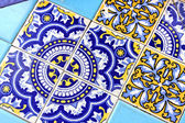 Close up of traditional Spanish ornate ceramic wall tiles. Multi coloured with pale & dark blues & yellow. — Stock Photo