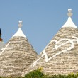 Painted Conical Truli roofs in the center of Alberobello, Puglia, Italy. — Stock Photo #46348543
