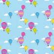 Vector seamless pattern with hot air balloons. — Stock Vector #19214485