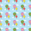 Stock Vector: Vector seamless pattern with hot air balloons.