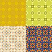 Vector set of abstract floras seamless textures. — Stock Vector