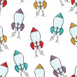 Vector seamless texture with cartoon rockets. — Vektorgrafik