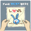 Drawing of a sheet of paper with cartoon rabbit illustration in hands. Vector. - ベクター素材ストック