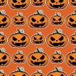 Seamless texture with halloween pumpkin - Stock Vector