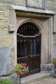 Church doorway, England — Stock Photo