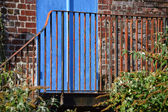 Rusty Railings in front of Blue Door — Stock Photo