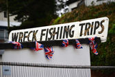 Wreck Fishing Trips sign — Stock Photo