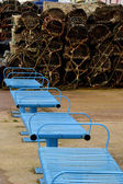 Blue seats and lobster pots — Stock Photo