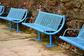 Blue harbourside seating — Stock Photo
